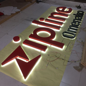 channel letters led sign with illuminated front of letters and stainless steel sides of letters