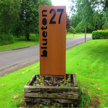 Outdoor weathering steel metal signage in rusted finish
